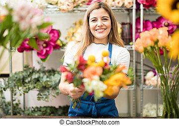 Happy florist showing her work