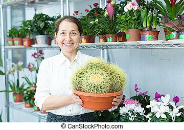 Happy florist with cactus