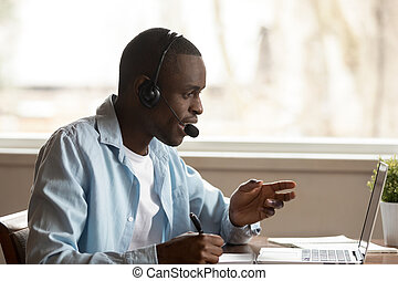 Happy focused african ethnic young guy attending online ...