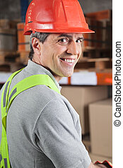 Happy Foreman At Warehouse - Portrait of happy mid adult...