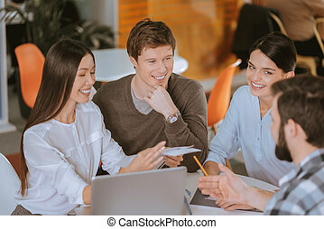 Happy four colleagues working jointly - Team brainstorm. Top...