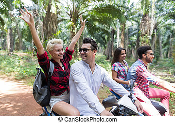 Happy Free Couples Driving Scooter Enjoy Travel In Tropical...
