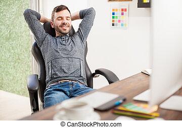 Happy freelancer taking a break from work