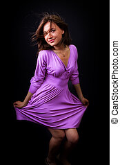 Happy fresh woman with elegant violet dress