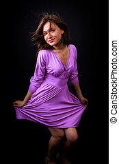 Happy fresh woman with elegant violet dress