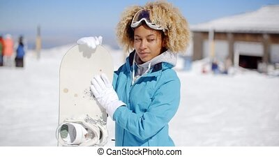Happy friendly young woman posing with a snowboard - Happy...
