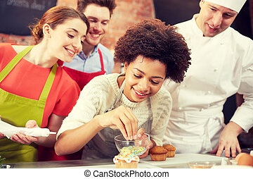happy friends and chef cook baking in kitchen - cooking...