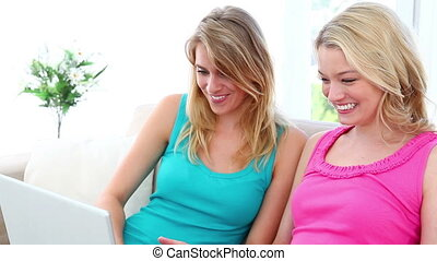 Happy friends buying online