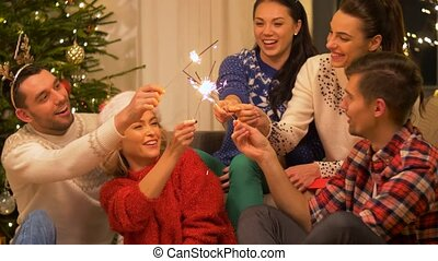 happy friends celebrating christmas at home party -...