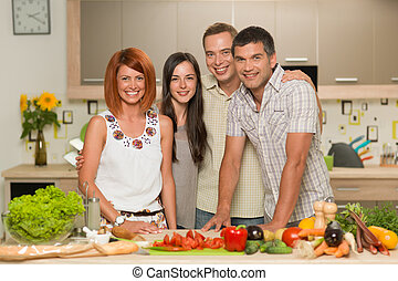 happy friends cooking
