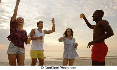 happy friends dancing at summer beach party - party, summer...