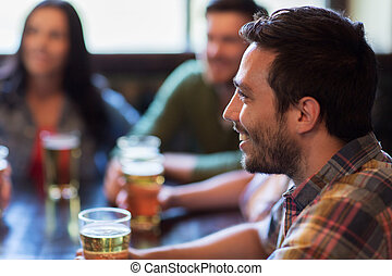 happy friends drinking beer at bar or pub - people, leisure,...