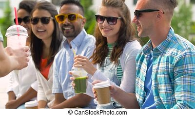 happy friends drinking coffee and shakes in city - people,...