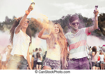 Happy friends during color festival - Happy group of friends...