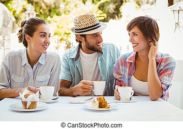 Happy friends enjoying coffee