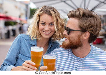 happy friends having beers on a sunny day