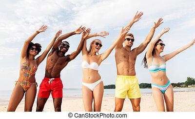 happy friends having fun on summer beach