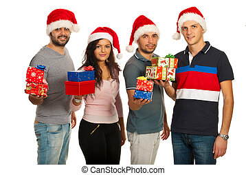 Happy friends holding Christmas gifts
