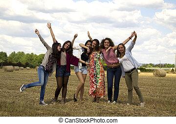 Happy friends in a field