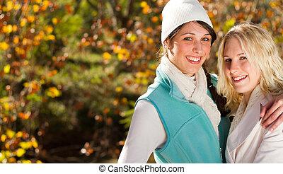 happy friends in autumn park