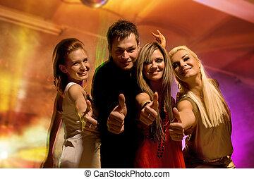 Happy friends in the night club