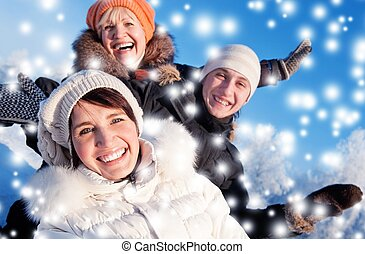 Happy friends on a winter background