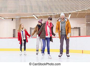 happy friends on skating rink - people, friendship, sport...
