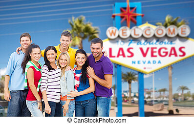 happy friends over welcome to las vegas sign