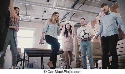 Happy friends play with ball in modern healthy office....