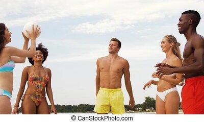 happy friends playing ball on summer beach - sport, summer...
