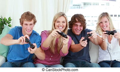 Happy friends playing video games together