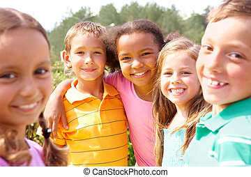 Happy friends - Portrait of happy preschoolers looking at...