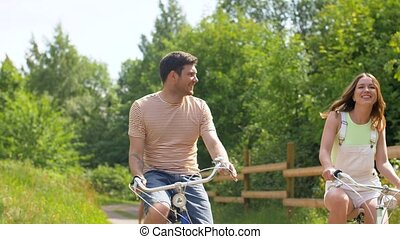 happy friends riding fixed gear bicycles in summer