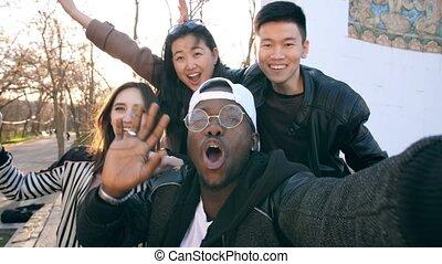 Happy friends taking a photo - Happy multiethnic friends...