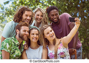 Happy friends taking a selfie