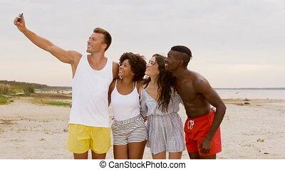 happy friends taking selfie on summer beach - friendship,...
