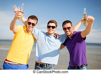 happy friends with beer bottles on beach - summer holidays, ...