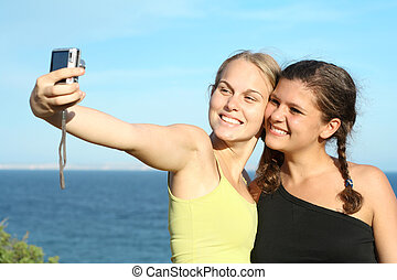 happy friends with camera