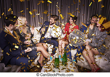 Happy friends with champagne celebrating
