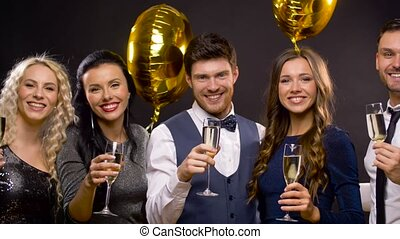 happy friends with champagne glasses at party