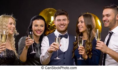 happy friends with champagne glasses at party - celebration,...