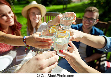 happy friends with drinks at summer garden party - leisure,...