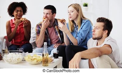 happy friends with drinks eating pizza at home - friendship,...