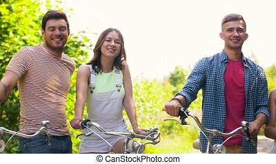 happy friends with fixed gear bicycles in summer
