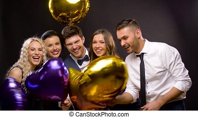happy friends with golden and violet balloons - celebration,...