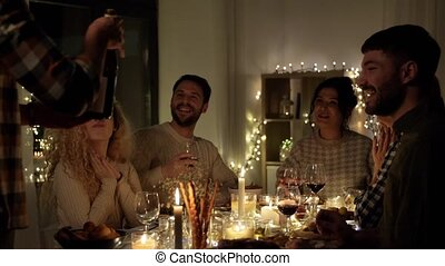happy friends with red wine at christmas party - holidays ...