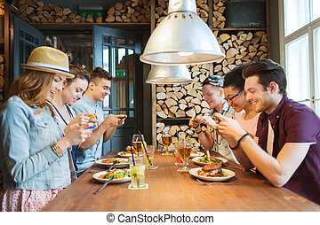 happy friends with smartphones picturing food - people,...