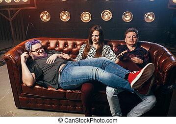 Happy friendship, threesome ha-ha on sofa, party in music...