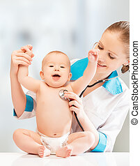Happy funny baby at doctor pediatrician. doctor listens to the heart with a stethoscope
