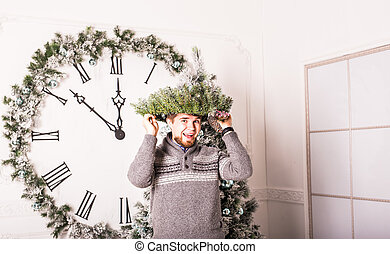 Happy funny male portrait with  Christmas wreath